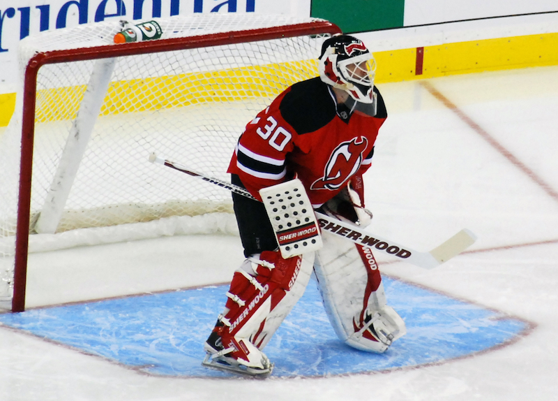 Ice hockey goalie Martin Brodeur guards the New Jersey Devils goal